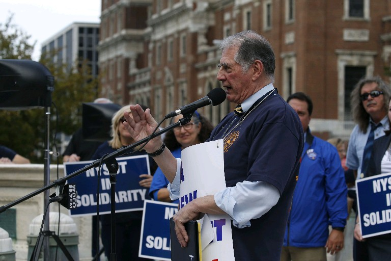 Buffalo Teachers Federation president Phil Rumore leads a protest rally in Niagara Square last fall while successfully pushing for a new contract. Now he's unopposed for a 19th term heading the union. (Robert Kirkham/News file photo)