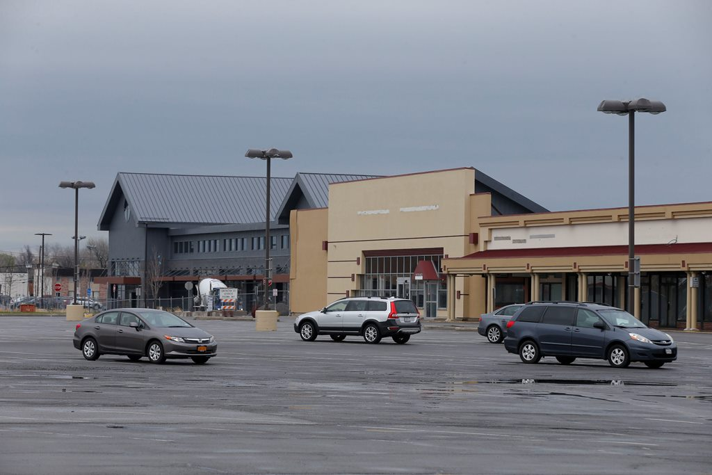 Only six stores remain in Northtown Plaza, and they remain uncertain of the developer's plans once Whole Foods, at left, opens as expected this summer. (Robert Kirkham/Buffalo News)