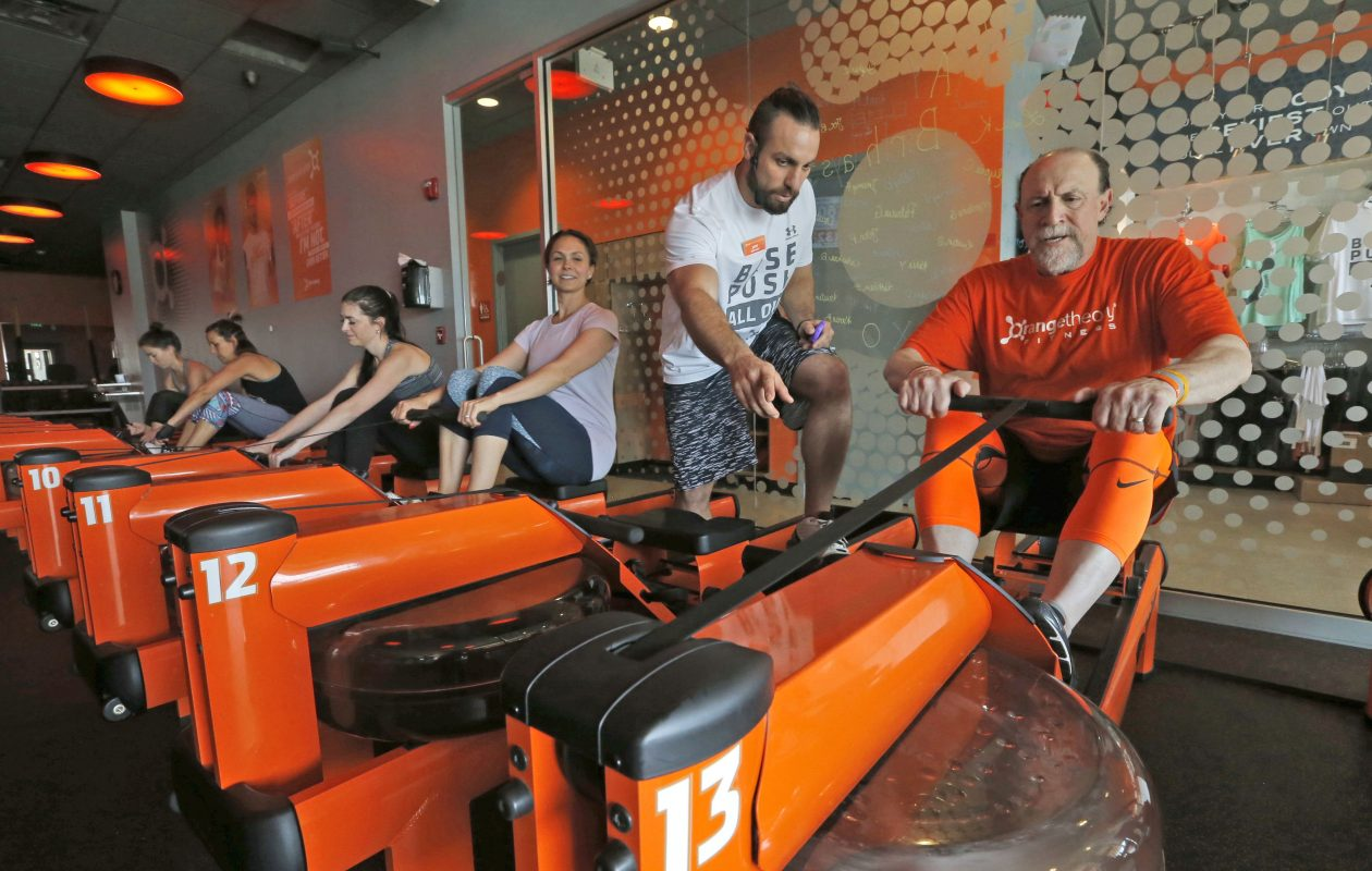 Richard Fink, right, working with Orangetheory trainer Jacob Bonano, has been on a mission to beat back diabetes since a scary blood sugar reading last year.  (Photos by Robert Kirkham/Buffalo News)