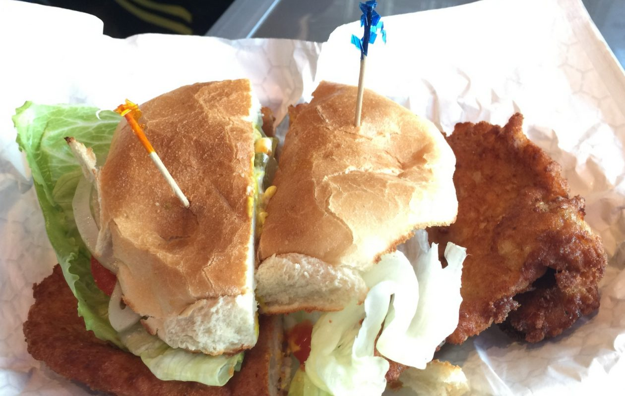 The breaded pork tenderloin sandwich is Sandwich Envy's flagship offering. (Andrew Galarneau/Buffalo News)