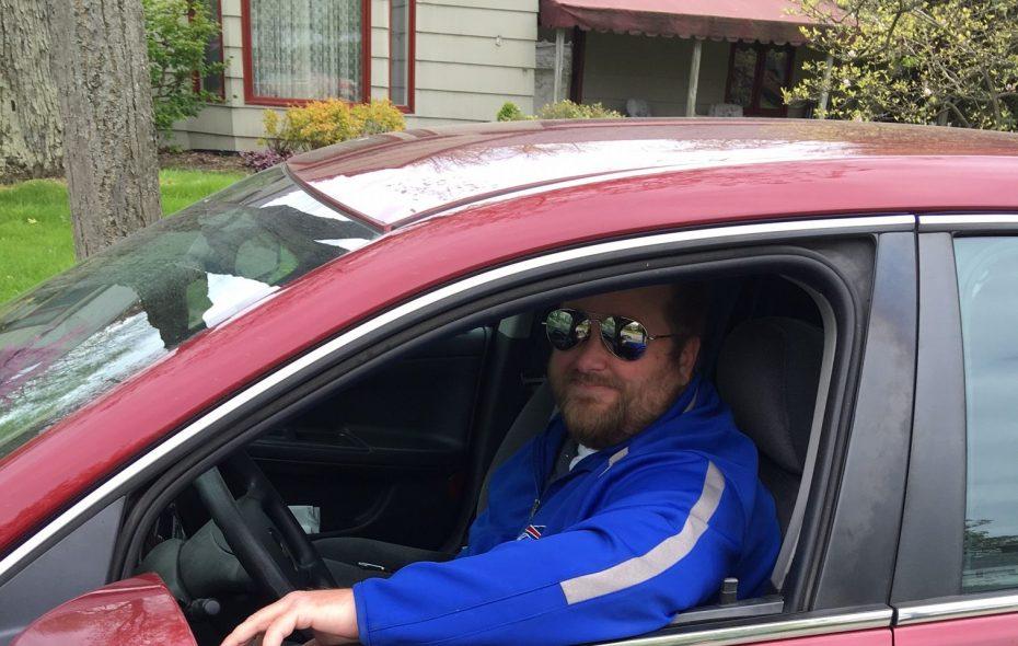John  Pawlowski, who eats a sub every week parked under the same tree on Zimmerman Boulevard in the Town of Tonawanda. (Stephen T. Watson / Buffalo News)