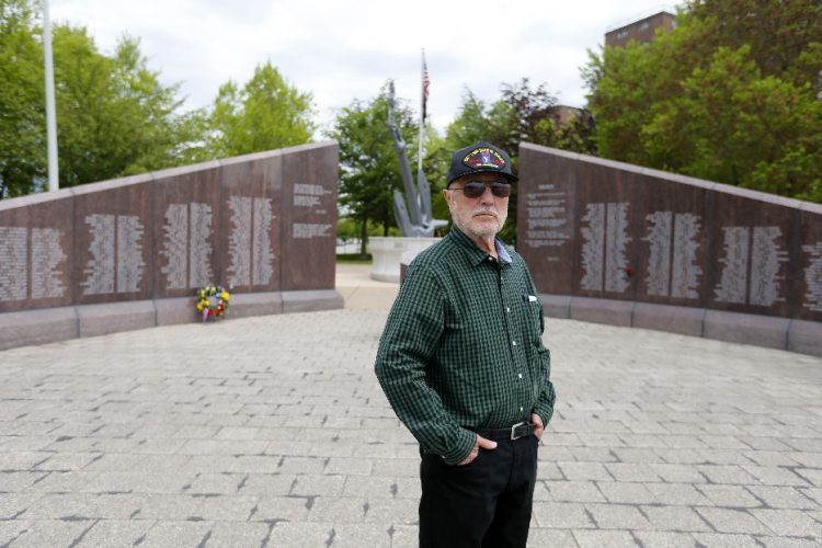 Al Brusetti stands at the Vietnam War Memorial at the Buffalo and Erie County Naval & Military Park in Buffalo. (Mark Mulville/Buffalo News)