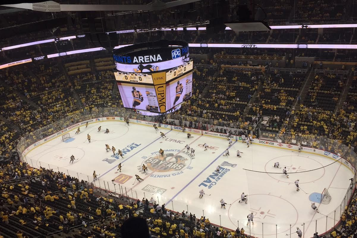 The Penguins and Predators hit the ice for warmups at PPG Paints Arena (Mike Harrington/Buffalo News).