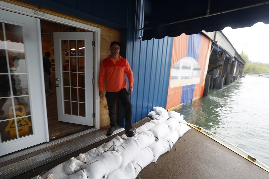 Brian Price, owner of Niagara Jet Adventures in Youngstown, worked on adding to the sandbags in front of his building. (John Hickey/Buffalo News)