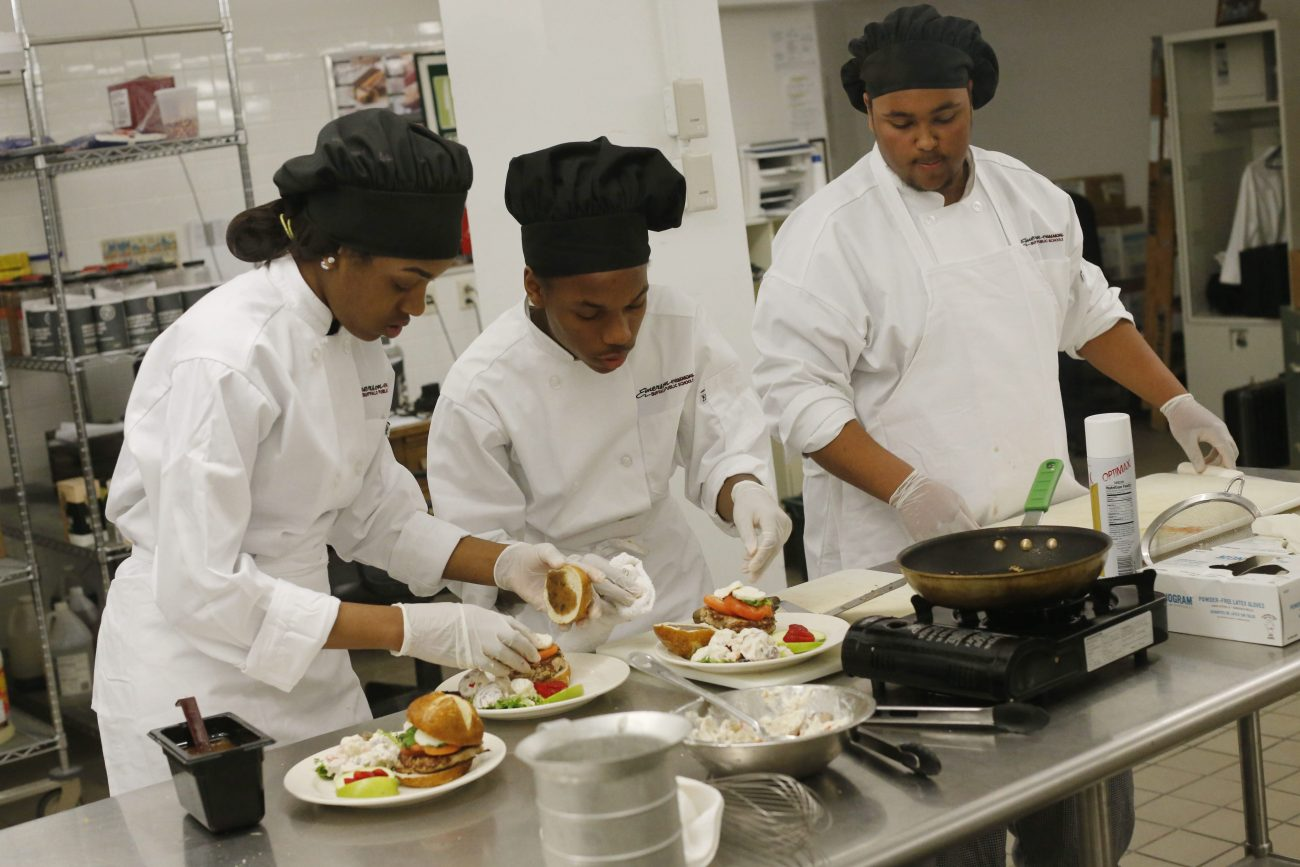 Emerson School of Hospitality students prepare a dish in 2016. While they may be a little more official, you can don a chef hat for a one-time cooking class. (Derek Gee/News file photo)