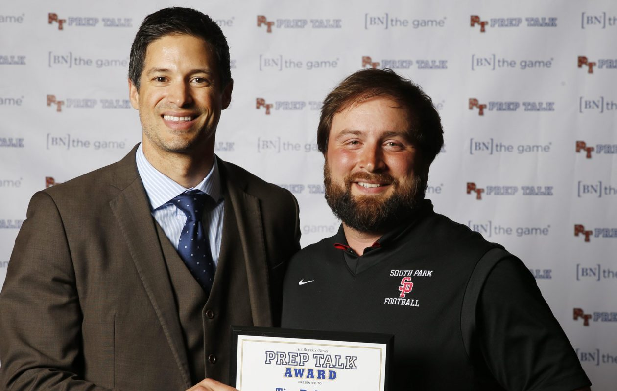 Steve Mesler, Olympic Gold Medalist, pictured with 2016 Prep Talk Coach of the Year Tim Delaney of South Park football. (Harry Scull Jr./Buffalo News)