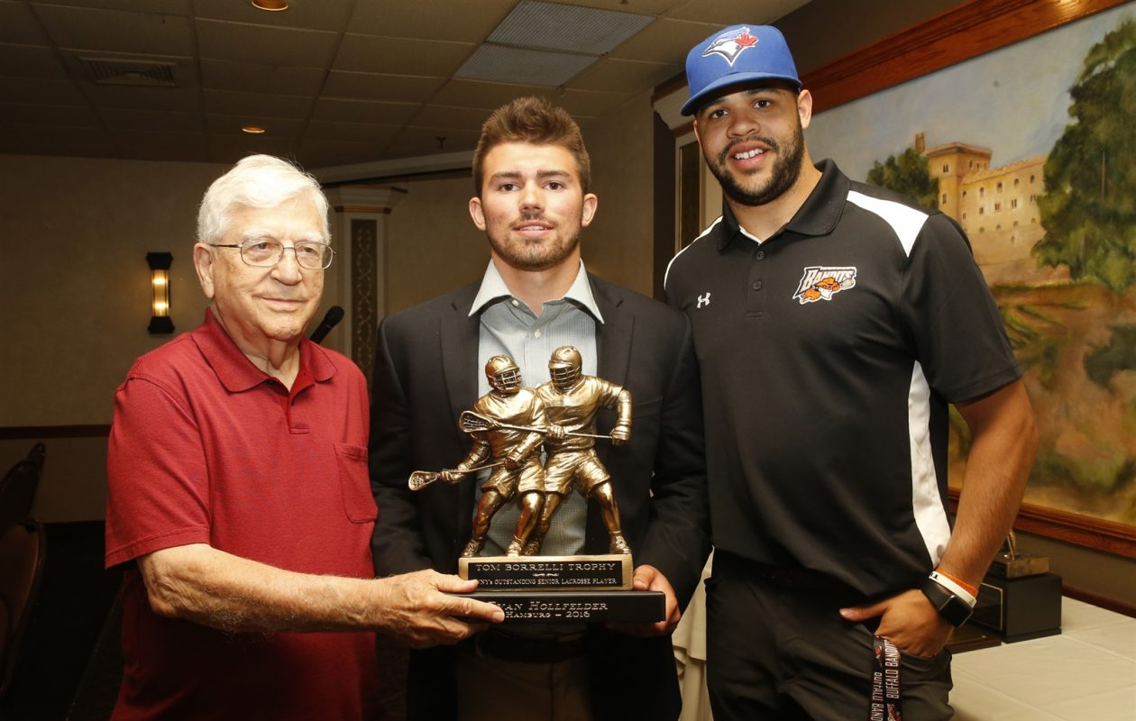 Winner of the 2016 Borrelli Award for boys lacrosse, Evan Hollfelder of Hamburg, is pictured with George Borrelli and Dhane Smith of the Buffalo Bandits. McKenna Rushford of Amherst was last year's girls winner. (Harry Scull Jr./Buffalo News)