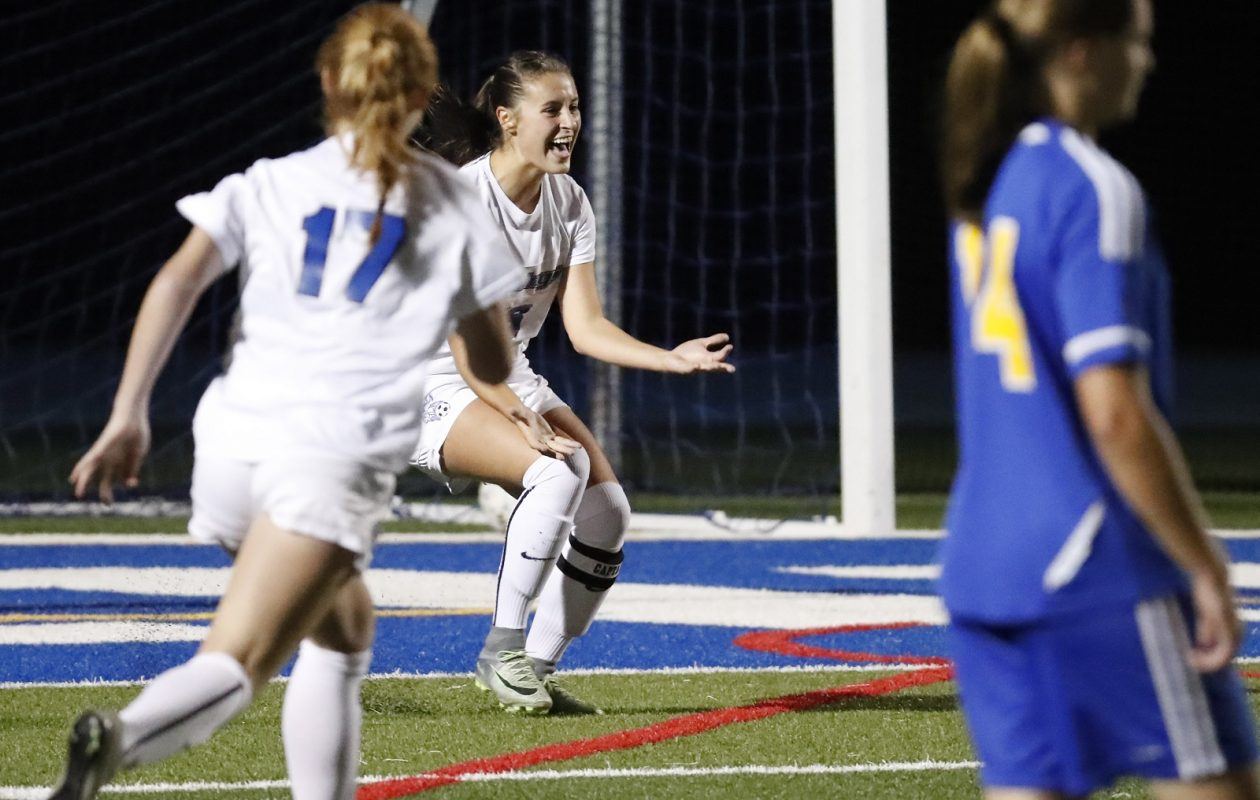 Grand Island's Maddie Pezzino, middle, celebrates her record-breaking goal against Lockport in October 2016. (Harry Scull Jr./Buffalo News file photo)