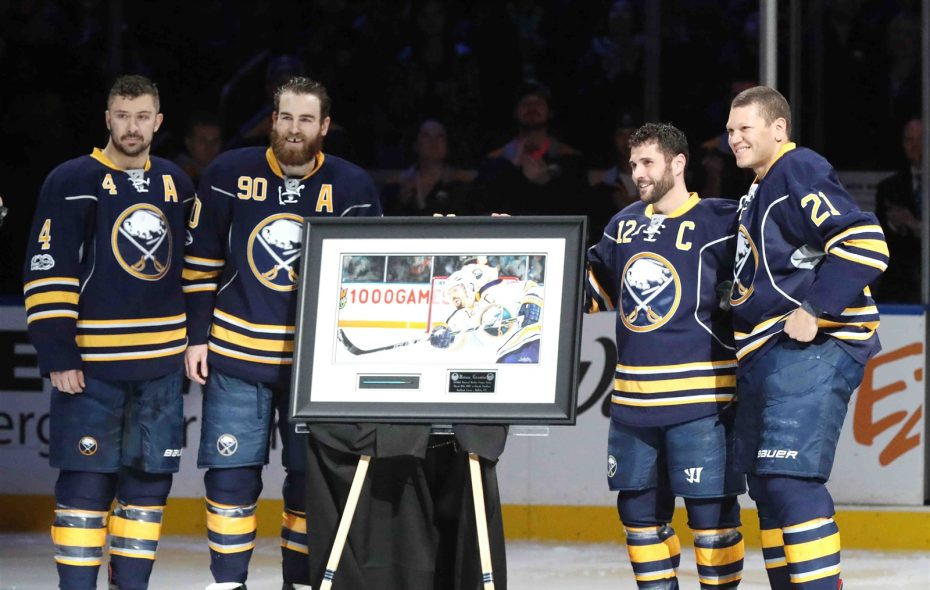 Brian Gionta (12) celebrated his 1,000th game in March with, from left, Josh Gorges, Ryan O'Reilly and Kyle Okposo. (James P. McCoy/Buffalo News)