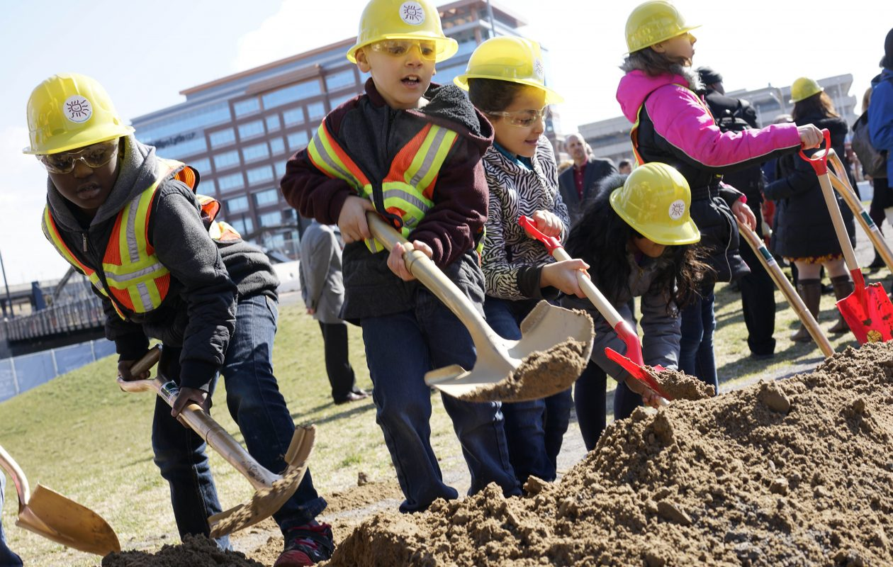 Second grade students from Waterfront Elementary have fun digging in the dirt at the groundbreaking for the new Explore & More Children's Museum at Canalside in March.  (Derek Gee/Buffalo News file photo)