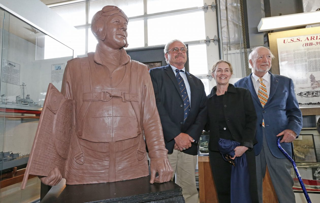 From left, son Phil McCluskey, sculpter Susan Geissler and WWII dive bomber pilot Lt. Commander George Walsh stand near the sculpture bust of Battle of Midway hero C. Wade McClusky that was unveiled at the Buffalo and Erie County Naval & Military Park on Sunday, June 4, 2017.  (Robert Kirkham/Buffalo News)