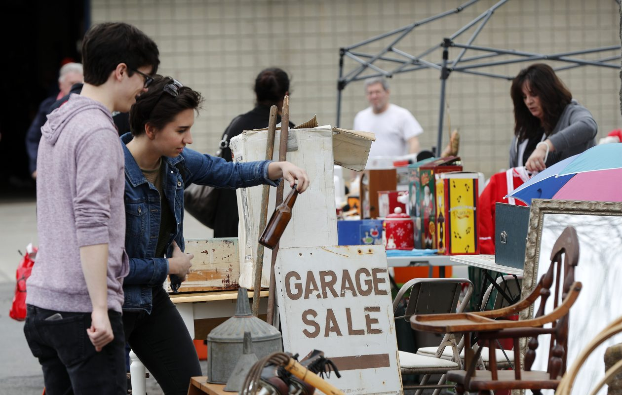 Joe Andrade, left, and Jess Trainor, right, look over some items during the 18th annual World's Largest Yard Sale at the Fairgrounds in Hamburg Friday in May.            (Mark Mulville/Buffalo News)