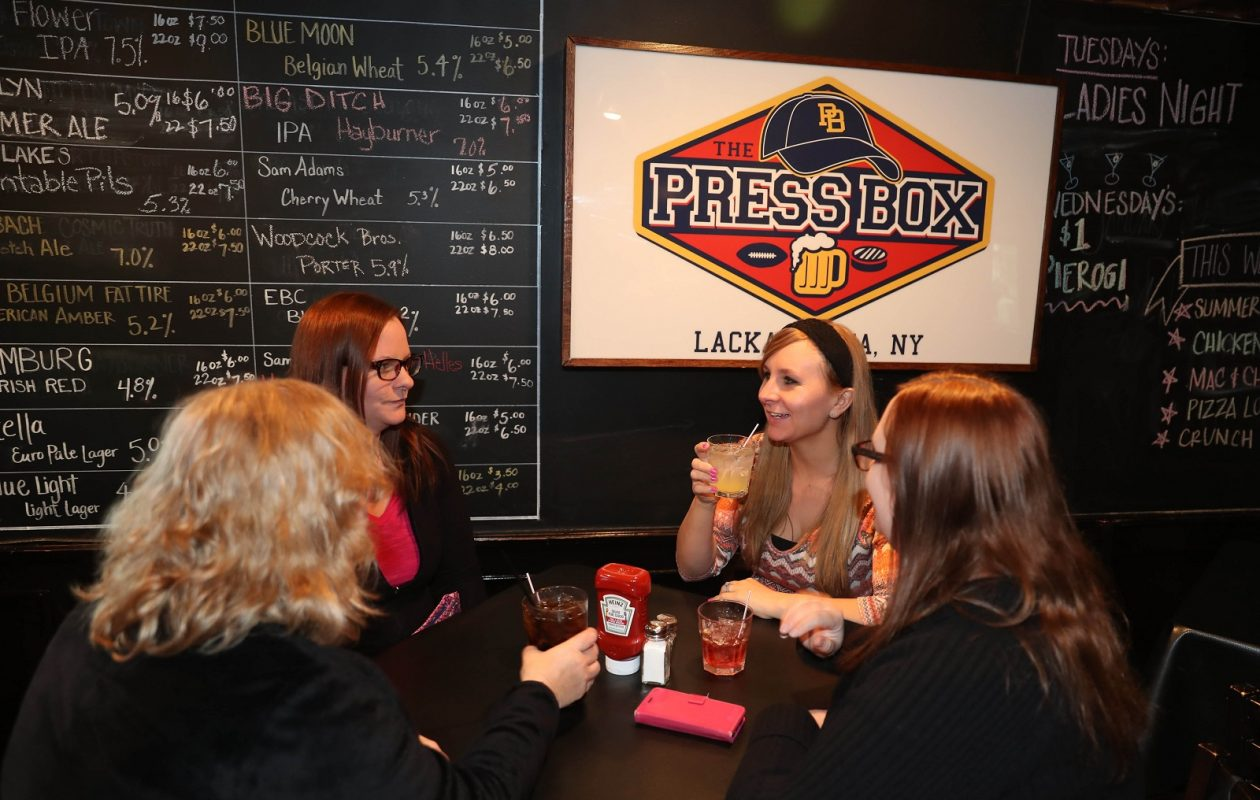 Catherine Brauen of West Seneca is out with her three daughters for some snacks and drinks. From left are Brauen, Melissa Santos of Angola, Kristin Stevanovic of West Seneca and Nicole Ford of Sloan.  (Sharon Cantillon/Buffalo News)