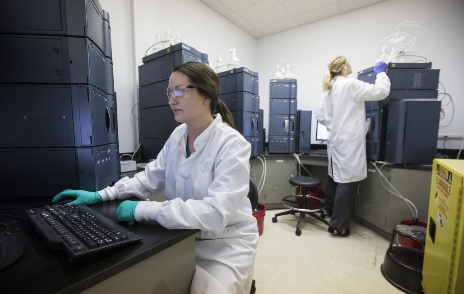 Quality control analysts Miranda Papp, left, and Laura Miller run tests in the laboratory at the Athenex facility in Newstead in May.  (Derek Gee/Buffalo News)