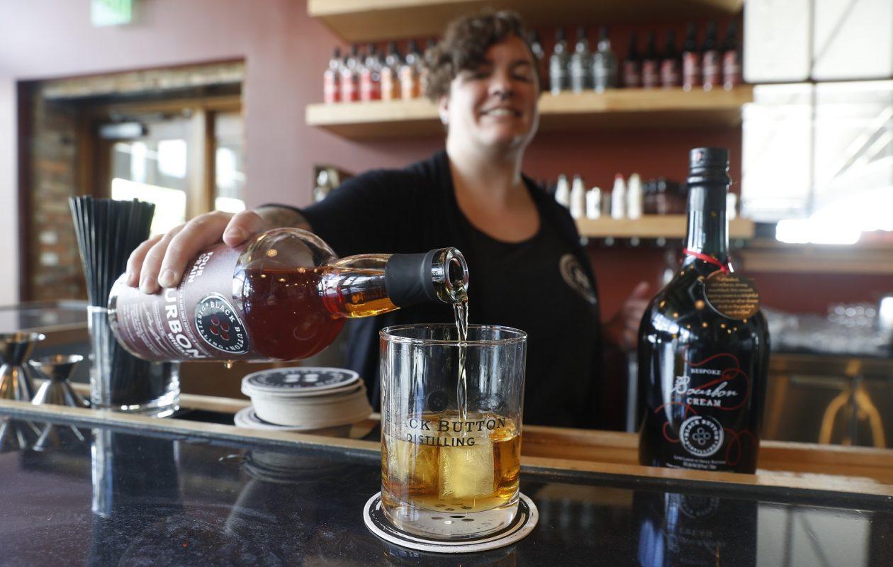 Black Button Distillery Buffalo area Manager Laura Sylyea Evans will run the Rochester company's new tasting room in downtown Buffalo. (John Hickey/Buffalo News)