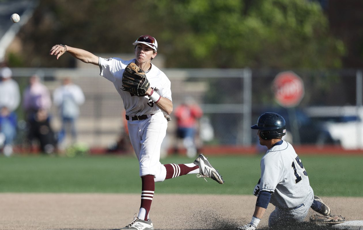 St. Joe's Luke Pierce turns a double play to end the game as the Marauders defeated Canisius 5-1 to advance to the Georgetown Cup championship series.  (Mark Mulville/Buffalo News)