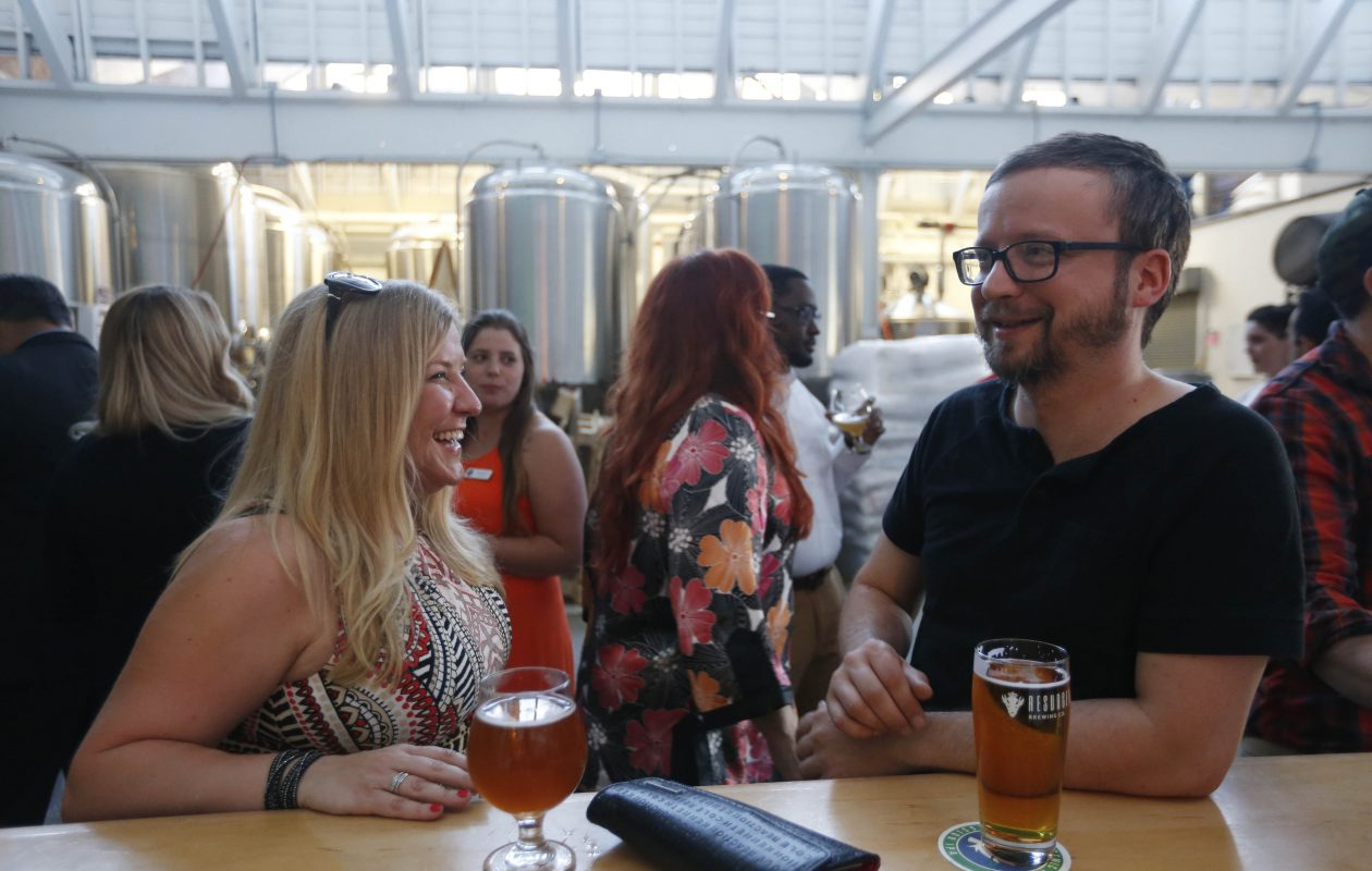 Kelly Barbus and Jimmy Collis enjoy drinks at Resurgence Brewing Company. (Sharon Cantillon/Buffalo News)