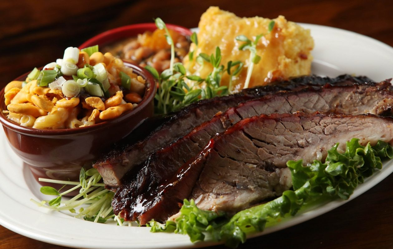 Smoke on the Water's angus brisket dinner.  It's made with angus beef brisket smoked for 14 hours with hickory and is accompanied with Nickel City mac and cheese, beans and greens, and corn bread with honey butter. (Sharon Cantillon/Buffalo News)