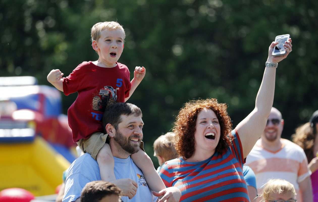 Teddy DeGolier reacts to seeing a parade of trucks for his birthday with his parents Ted and Nicole during his birthday gathering at their home in Akron on Sunday, June 11, 2017.  (Mark Mulville/Buffalo News)