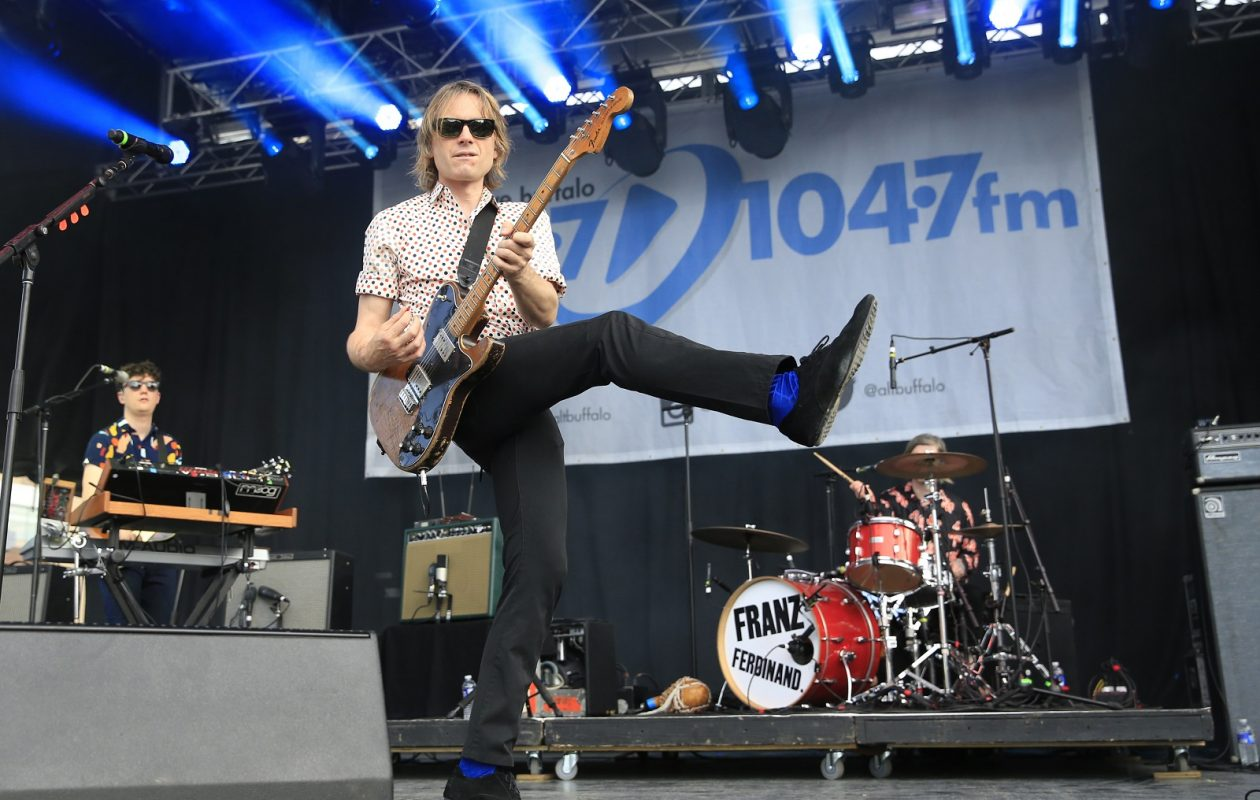 Alex Kapranos of Franz Ferdinand jumps around on stage during the band's set at Kerfuffle at Canalside. (Harry Scull Jr./Buffalo News)