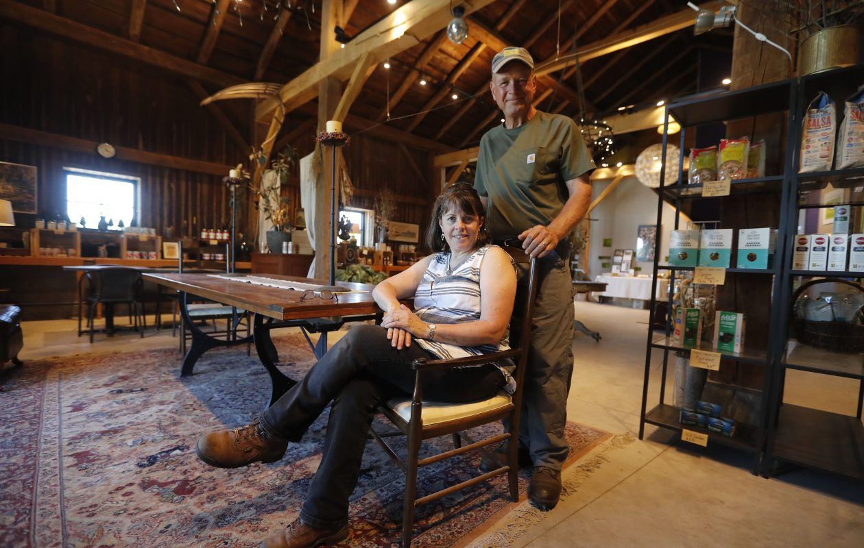 Tom and Vivianne Szulist relax in the newly renovated Legacy Barn at Singer Farm Naturals in Appleton. The vintage barn is the heart of their innovative farm. (Mark Mulville/Buffalo News)