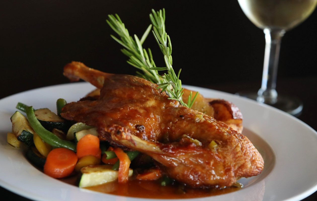 The Waterstone Grill's half roasted duck comes with chef-selected sauce and sides. (Sharon Cantillon/Buffalo News)