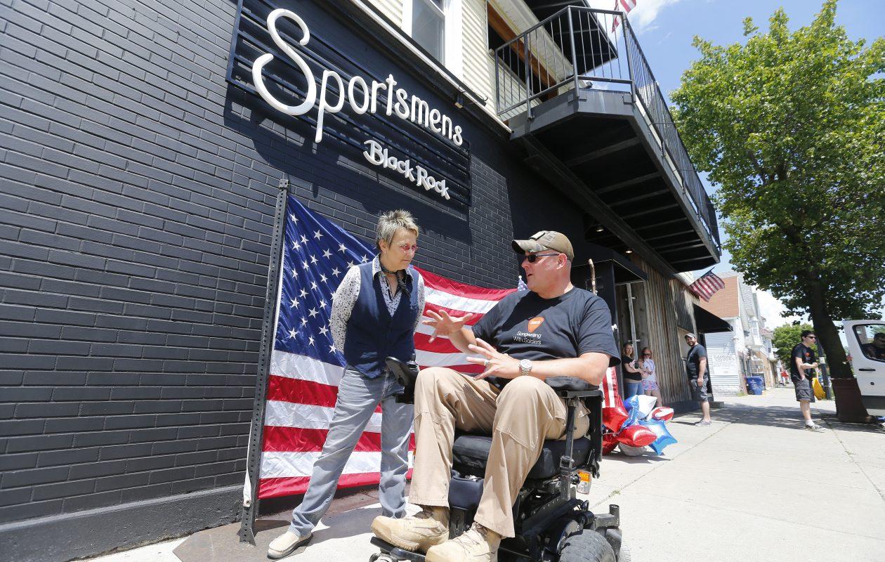 Army veteran Sgt. Joshua Geartz talks with singer/songwriter Mary Gauthier outside of the Sportsmen's Tavern Sunday.          (Mark Mulville/Buffalo News)