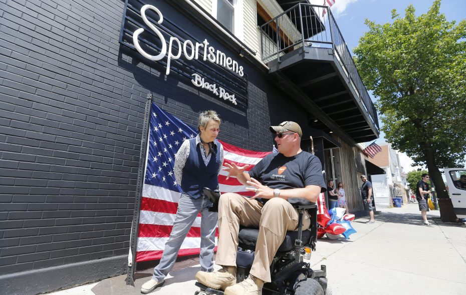 Army veteran Sgt. Joshua Geartz talks with singer/songwriter Mary Gauthier outside of the Sportsmen's Tavern Sunday.          (Mark Mulville/Buffalo News)
