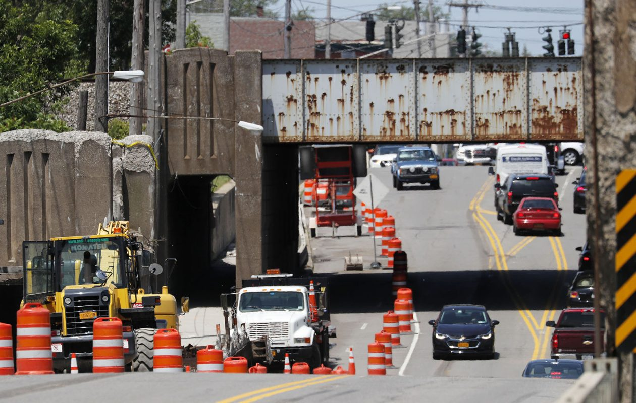 Crews work to remove an abandoned railroad bridge over Transit Road in Depew on June 28. (Mark Mulville/Buffalo News)