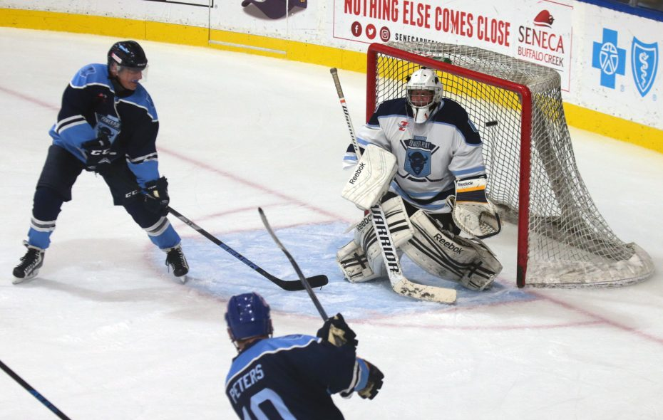Geoff Peters (10) of the Blue Team scores on the White Team goalie Andrew Tokasz at the  11 Day Power Play event on Friday, June 23, 2017 at HarborCenter in Buffalo. The fundraiser, which started Thursday night, is trying to raise more than $1 million for Roswell Park Cancer Institute.  Forty players will be attempting to break the Guinness Book of World Records' mark for the longest hockey game – more than 250 hours of continuous hockey. (John Hickey/Buffalo News)