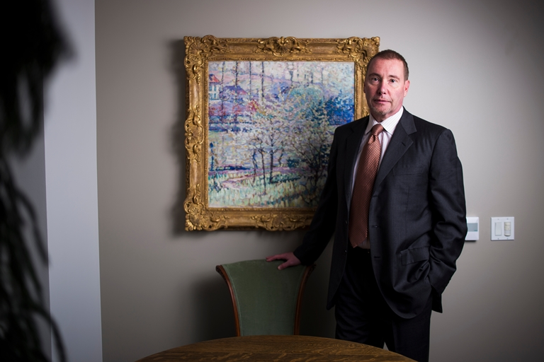 "Jeffrey Gundlach sits in front of the painting ""Printemps ˆ Uccle (Springtime in Uccle)"" by Joseph Raphael in his office at DoubleLine Capital. (Jenna Schoenefeld/Special to The News)"