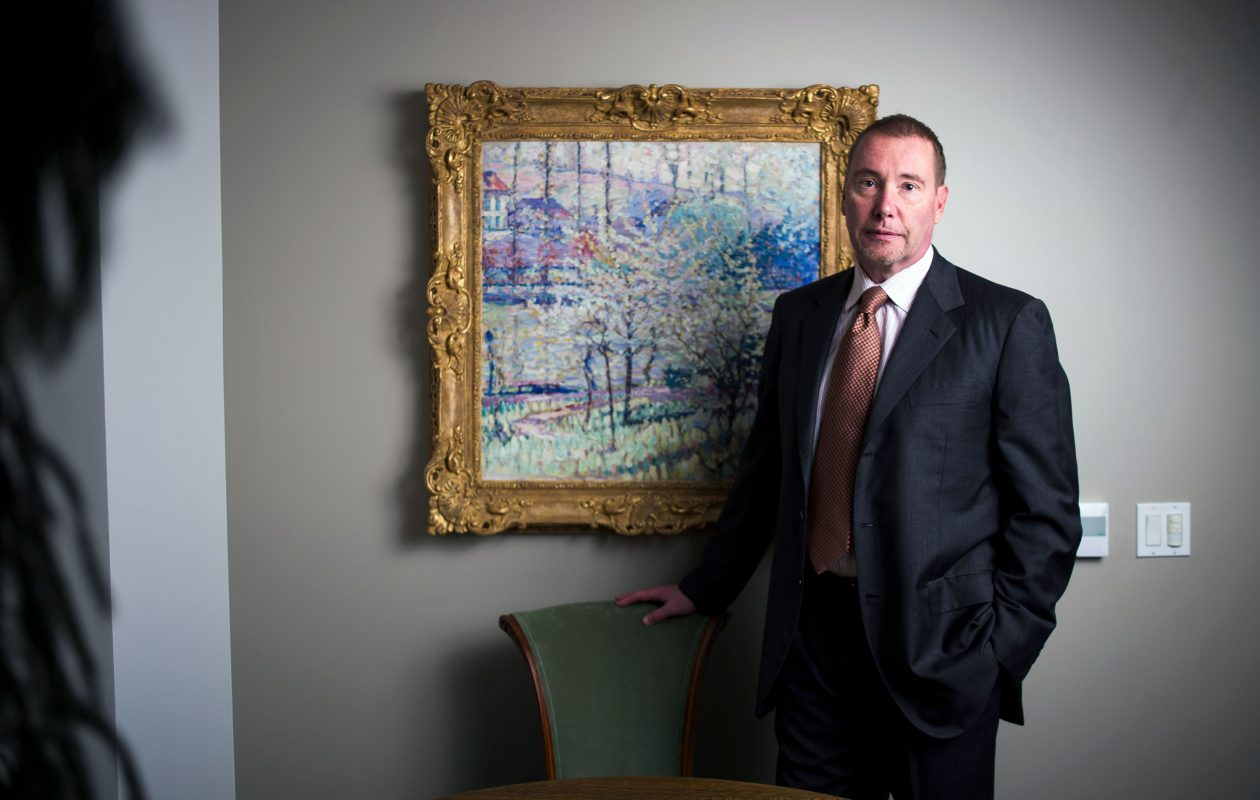 Jeffrey Gundlach stands before with the painting 'Printemps ˆ Uccle (Springtime in Uccle)' by Joseph Raphael in his office at DoubleLine Capital. (Jenna Schoenefeld/Special to The News)