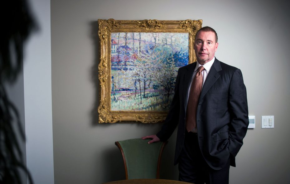 """Jeffrey Gundlach stands before with the painting """"Printemps ˆ Uccle (Springtime in Uccle)"""" by Joseph Raphael in his office at DoubleLine Capital. (Jenna Schoenefeld/Special to The News)"""