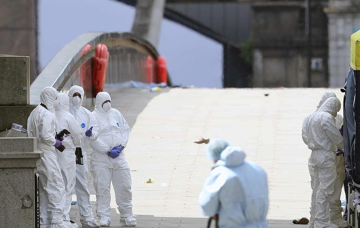 Forensic officers work on London Bridge after Saturday night's terrorist attack in London, England. Police continue to cordon off an area after responding to the attacks on the bridge and at Borough Market, where seven people were killed and at least 48 injured. (Dan Kitwood/Getty Images)