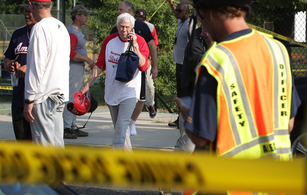 ALEXANDRIA, VA - JUNE 14:  U.S. Rep. Jack Bergman (R-MI) (C) leaves the scene of this morning's shooting at Eugene Simpson Stadium Park June 14, 2017 in Alexandria, Virginia. U.S. House Majority Whip Steve Scalise (R-LA) was among five wounded in the attack, including the suspected gunman, as Republican congressional members practiced for a charity baseball game.  (Photo by Alex Wong/Getty Images)