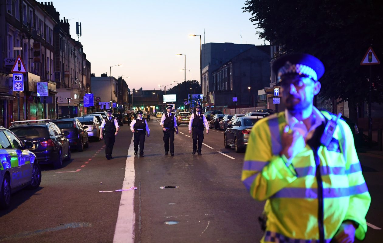 Police officers guard a road leading to Finsbury Park Mosque after an incident in which a van hit worshipers outside the building on June 19, 2017, in London.  (Photo by Carl Court/Getty Images)