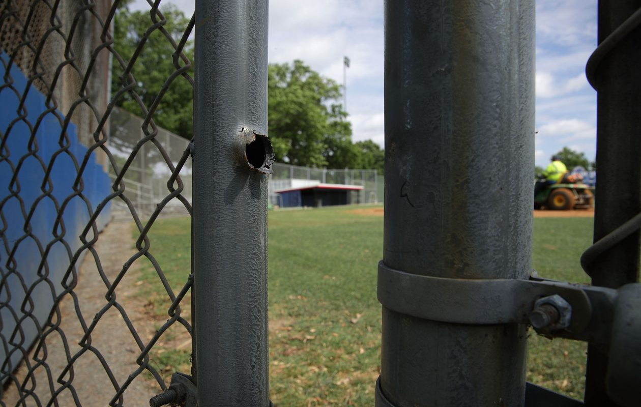 A bullet hole is seen on a gate at the Eugene Simpson Stadium Park, the site where  House Majority Whip Rep. Steve Scalise was shot by gunman James Hodgkinson, June 19, 2017  in Alexandria, Virginia. Investigators have concluded their investigation at the shooting scene and the area has been reopened to the public.  (Photo by Alex Wong/Getty Images)