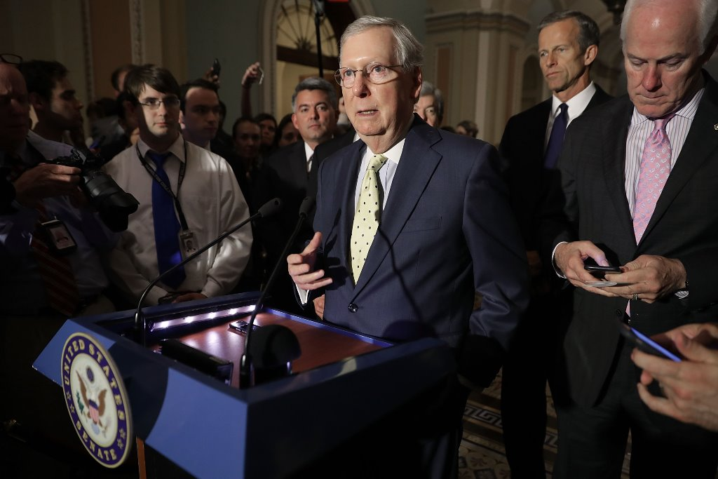 U.S. Senate Majority Leader Mitch McConnell (R-KY) (C) approaches the microphones before talking with reporters with Sen. Cory Gardner (R-CO) (L), Sen. John Thune (R-SD) and Senate Majority Whip John Cornyn (R-TX) (R). (Getty Images)