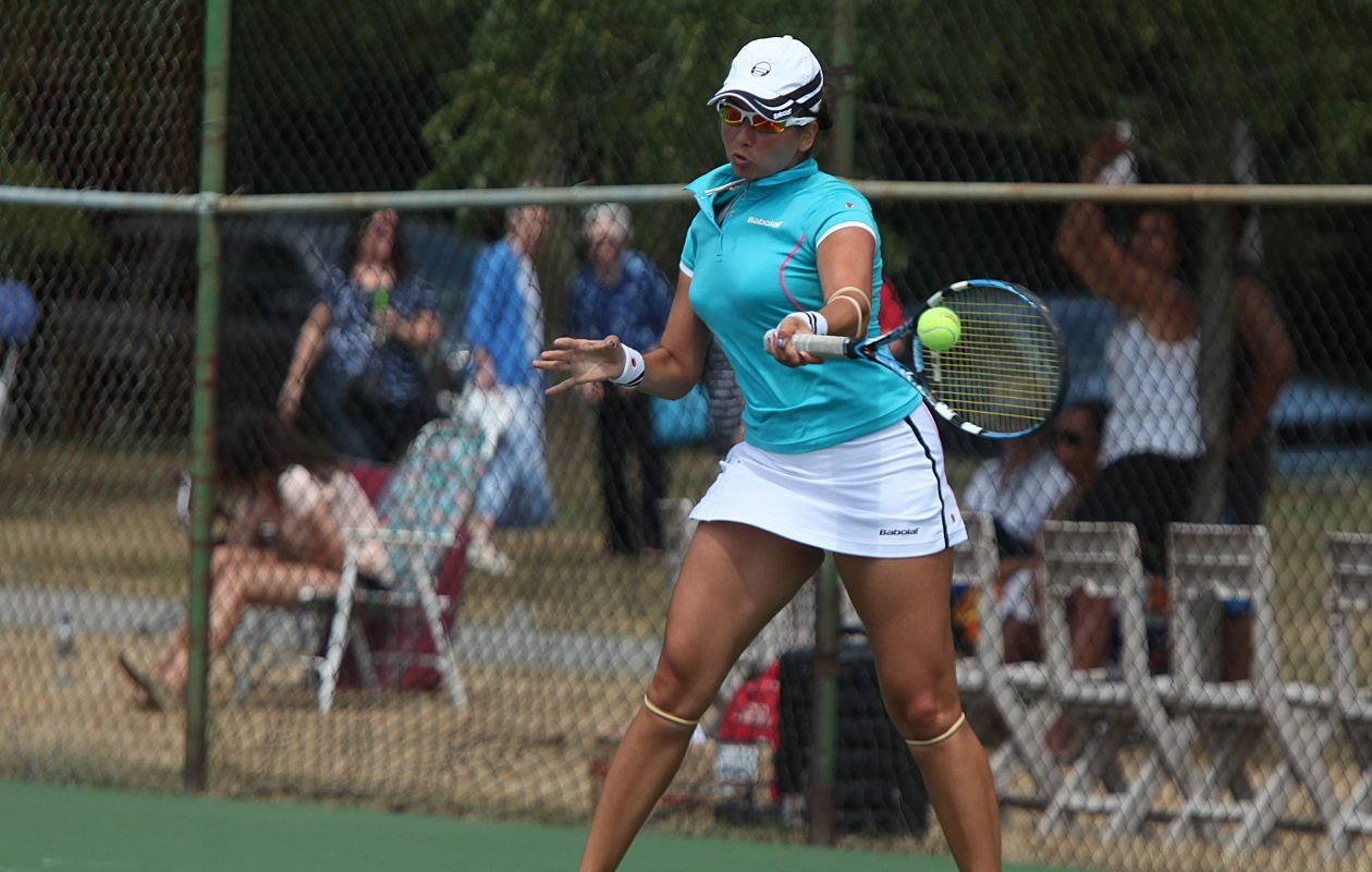 Andreea Novaceanu returns a shot during her 2012 Buffalo MUNY Tennis Tournament women's championship victory at Delaware Park. (Buffalo News file photo)