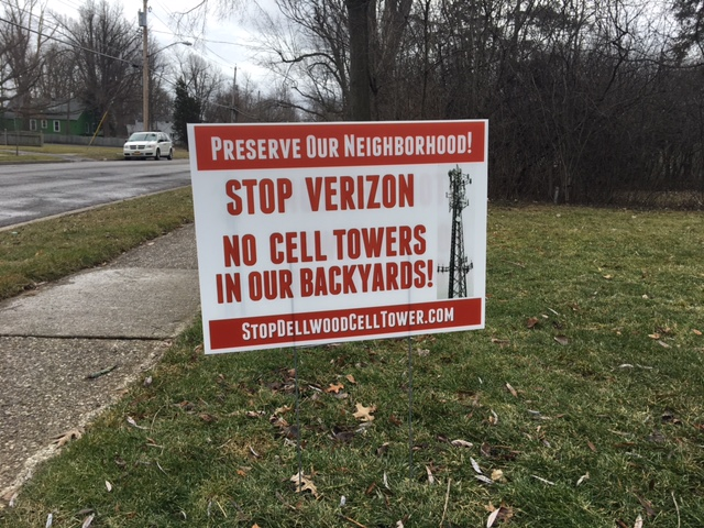 A sign on the front lawn of a home on Dellwood Road in Amherst shows opposition to a proposed Verizon cell phone tower being erected near there. (Stephen T. Watson / Buffalo News)