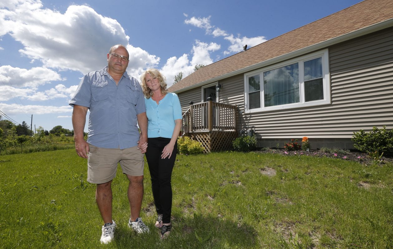 Former Boston Town Clerk Jennifer Mule and her husband, Gary Ballowe,  outside their house on Omphalius Road. (Robert Kirkham/Buffalo News)