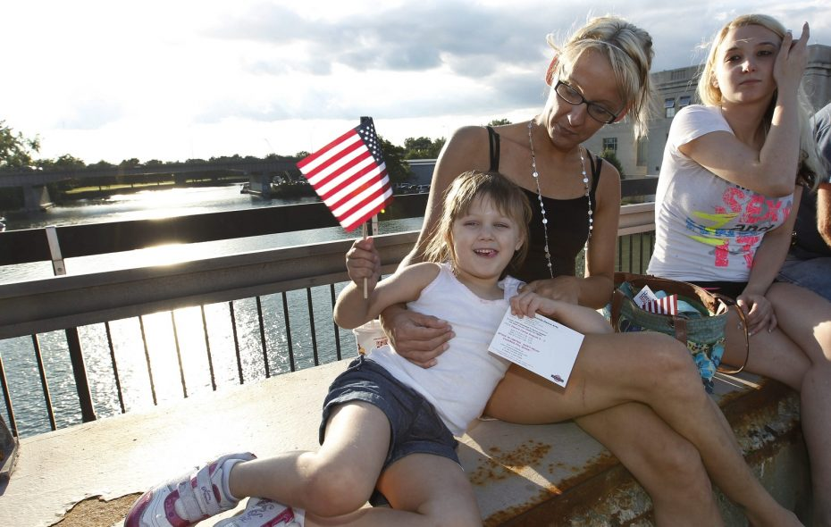 Jera Czajkowski and her daughter Ella, both of North Tonawanda watch the Canal Fest parade from the bridge going over the canal, in 2014. (Sharon Cantillon/Buffalo News)