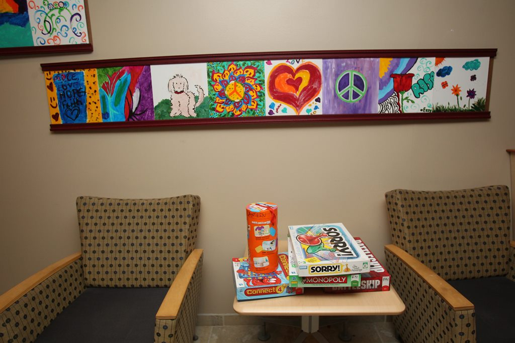 The canteen at the West Seneca Children's Psychiatric Center, used as a meeting room for family visits for young patients and for parties. The paintings on the walls are done by kids and their families on family nights. (Sharon Cantillon/News file photo)