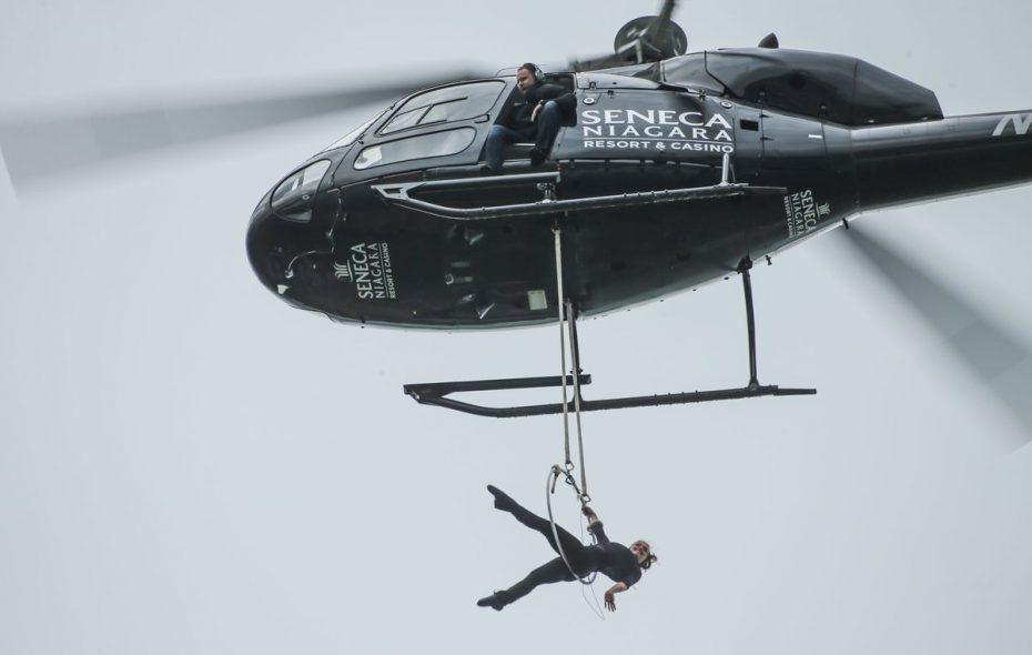 As Erendira Wallenda dangles from a helicopter over Niagara Falls, her husband, Nik Wallenda keeps an eye from the open chopper door. (Derek Gee/Buffalo News)