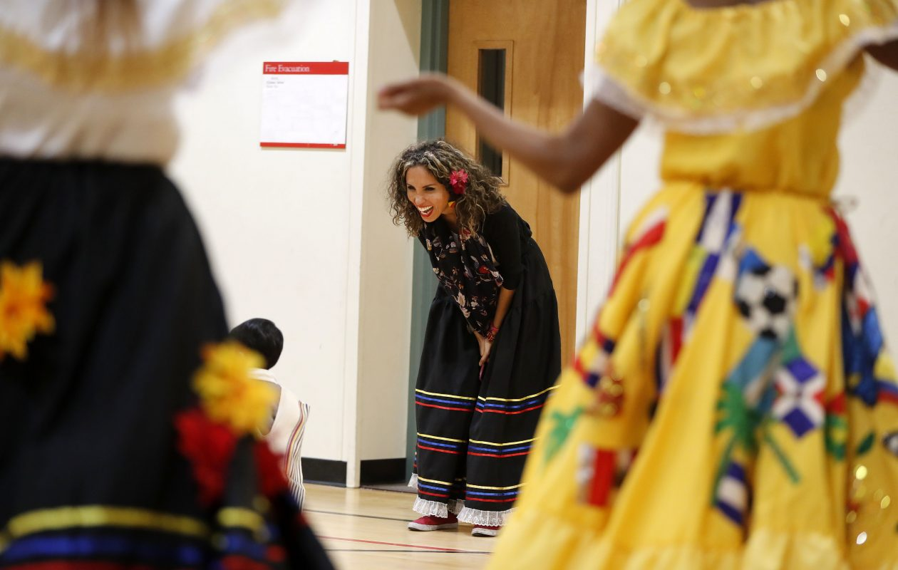 MarCe Zerrate, executive director of Amor and Hertiage Traditional Dance Company, laughs with children as they join in on a traditional Columbian dance at Explore & More in East Aurora earlier this year.  Wander the World Wednesdays will feature Columbian culture again on Aug. 30. (Mark Mulville/Buffalo News file photo).
