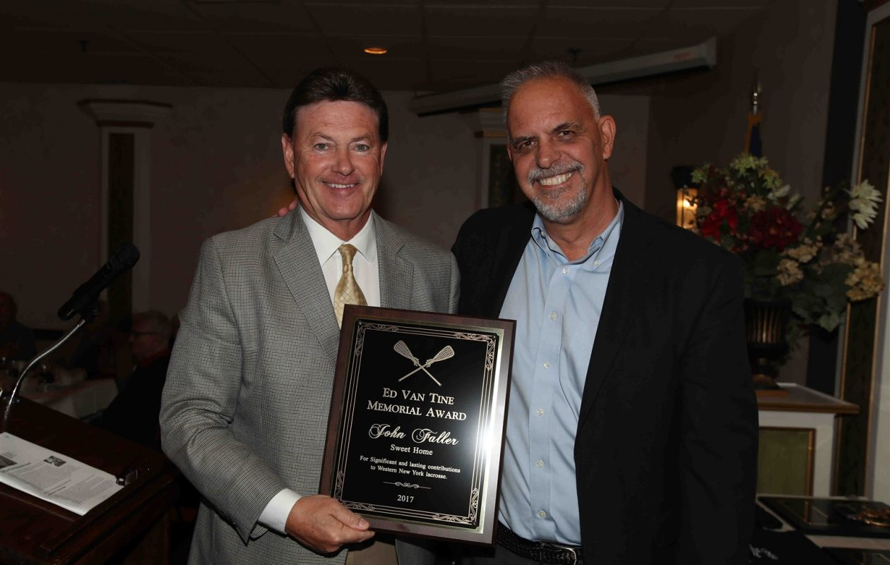 John Faller is presented with the Ed Van Tine Memorial Award for his contributions to the sport of lacrosse by the Buffalo News' Bob DiCesare during the annual Tom Borrelli Memorial Awards on Monday night at Ilio DiPaolo's Restaurant. (James P. McCoy/Buffalo News)