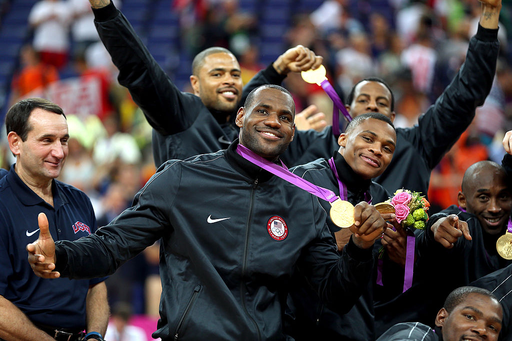 LeBron James and teammates celebrate on the podium following the medal ceremony for the Men's Basketball on Day 16 of the London 2012 Olympics Games at North Greenwich Arena on August 12, 2012 in London, England.  (Getty Images)