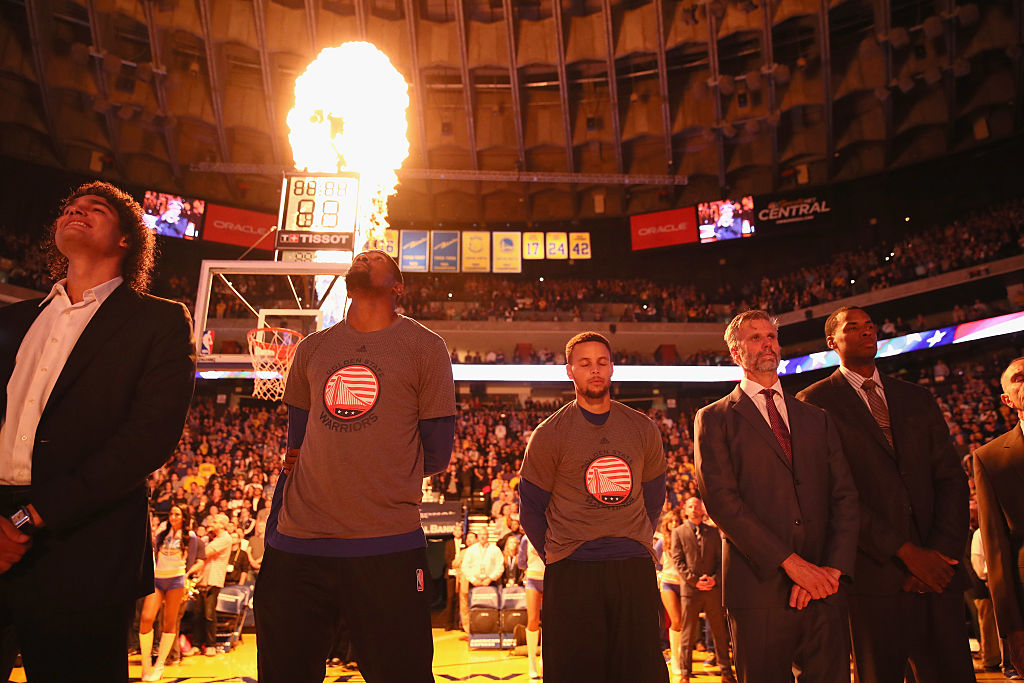 The Warriors' Kevin Durant and Stephen Curry stand for the National Anthem before their game against the Dallas Mavericks at ORACLE Arena on November 9, 2016. (Getty Images)