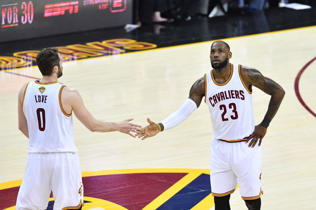 Kevin Love and LeBron James give five during Game Three of the 2017 NBA Finals (Getty Images)