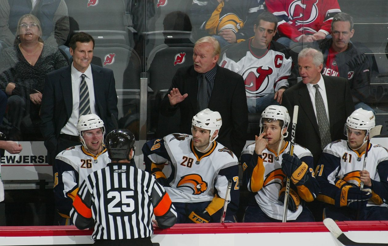 James Patrick, left, has been by coach Lindy Ruff's side since 2006-07. (Getty Images)